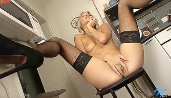Blonde in black stockings loves fingering herself
