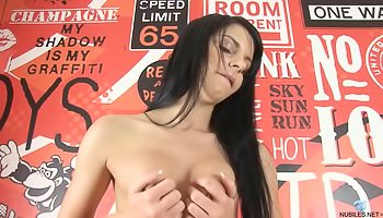 Tender brunette is fingering her holes gently