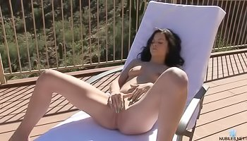 Awesome brunette is masturbating outdoor