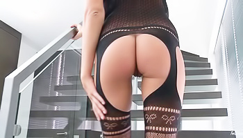 Leggy beauty teasing on the stairs