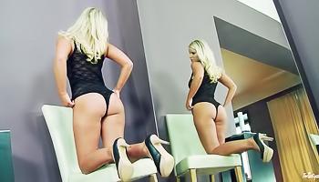 Onesie-wearing blonde cums hard on cam