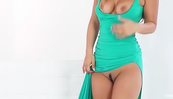 Green dress brunette masturbating on a chair