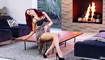 Fiery redhead masturbating on a table