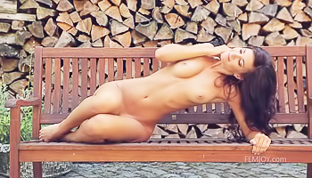 Long-haired brunette slowly stripping outdoors